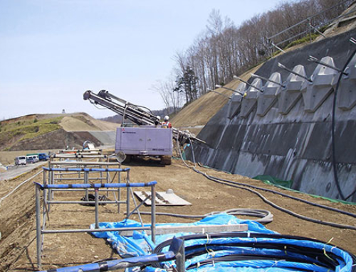 Reinforcement of a Containment Wall